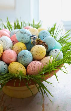 Showcase DIY speckled eggs in a nest of wheatgrass. First, dye hard-cooked eggs in pastel shades (or paint craft eggs). Then make flecks: Dilute brown acrylic paint with water until it's the consistency of cream. Dip an old toothbrush into the paint and, with the brush a few inches from the egg, run your finger across the bristles, splattering paint onto the shell (lay egg horizontally, splatter, let dry, rotate, and repeat).