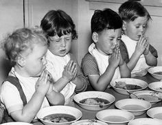 ohh cute! Children saying grace before eating    New Zealand Free Lance. Children saying grace before eating [1950s]. Photographic Archive, Alexander Turnbull Library (Ref:1/2-C-002014-F)
