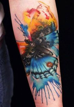 Watercolor butterfly tattoo on arm.. with lace