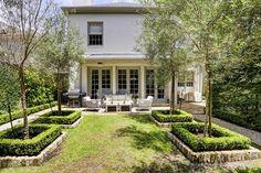 Gorgeous back yard symmetry. Bricks with green... (via Cote de Texas blog)