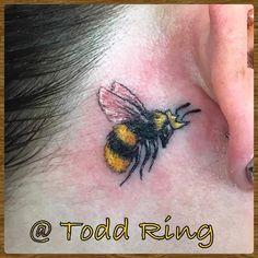 Yellow and Black Bee Ear Tattoo