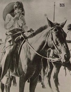 Cowgirl 1926...still need to look good while packin' pistols...