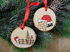 Well it looks like Santa got stuck in the chimney after leaving his hat on a fence post! These two birch tree slices were wood burned free hand and also painted by me. These ornaments will be so cute on your tree or hang them anywhere. They could also be used as a gift tags. Entirely
