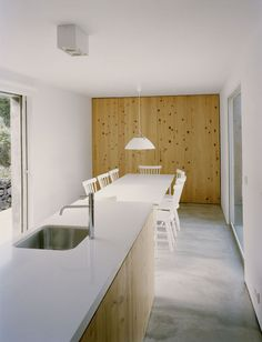 """In a home on a Portuguese island, a single, texturedwall of local """"criptoméria"""" wood draws the eye.  Courtesy of Paulo Catrica."""