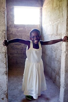 Compassion International in Tanzania. Look at this precious child, she is just glowing! :)