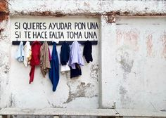 """TO GIVE or TO TAKE — A LO DEJAS o A LO TOMAS """"If you want to help people, please leave one piece of clothing. In case you need one, please take it."""" Templo Nuestra Senora del Patrocinio, Oaxaca City"""