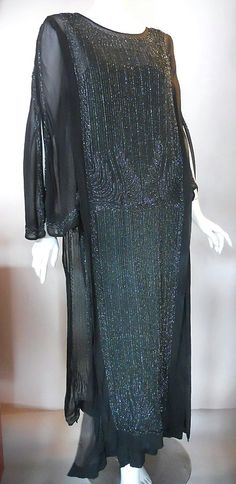 1920s black beaded evening gown, DCV archives... Women's Fashion in the roaring twenties was all about elegance.