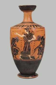 "Oil flask (lekythos) with Achilles, Ajax and Athena Greek, Archaic Period, about 500 B.C. Achilles and Ajax are seated on blocks and compete in a game, possibly dice. In front of Achilles is the vertical inscription ""I have four"" (TETARAFERO) and in front of Ajax, in the same manner, is the inscription ""I have two"" (DUOFERO). The goddess Athena officiates in the center. Each warrior has removed his helmet and placed it on top of his shield, planted on the ground behind him."