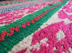 THIS ITEM SHIPS DIRECTLY FROM PERU---  This is a bold & bright frazada with complex designs that shows off a range of saturated colors. The showstopper of this rug is the unusual bright green center stripe, hot pink center seam, and green border. Colors in this rug include: green, pink, orange, royal blue, creme, purple  As with all of my frazadas, this textile was made by hand in an Andean weaving community in the mountains of Peru. It is best used as a very thick blanket, ultra-warm bed...