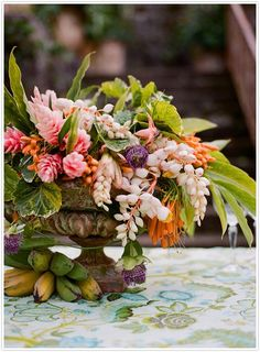 I like this type of container for the centerpieces--each can be made slightly differently, but the feel of the vessel is old world
