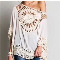 Ivory boho tunic Beautiful semi sheer tunic with crochet trim details . Nwot . Runs big and meant to be . Also available in navy . Sold out in large now . Medium will fit large though . Vivacouture Tops