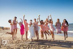 It's all about the beach!  I love all the pink shades of the girl's dresses.  -Mary Basnight Photography