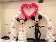 Bespoke designed arch with 3ft heart & of course as with any Dusney themed wedding...Mickey & Minnie Bride & Groom.