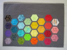 Items similar to Big Bold Baby Hexagons Quilt from Quilts by Elena Modern gray background with bright appliqued hexagons Wall Hanging Ready to Ship on Etsy. , via Etsy.