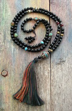 Mala necklace made of 8 mm - 0.315 inch faceted onyx and two hematite stones. Together they count as 108 beads. The mala is decorated with faceted agate and handmade Nepalese beads - look4treasures on Etsy