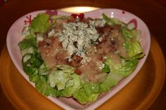 2012: Valentine's Dinner Salad. One of our favorite salads. Delish! Recipe:      Onion Mustard Vinaigrette Salad    ¼  Onion chopped (also red)  ¼ cupCider Vinegar  2 tsp.Spicy Brown Mustard  ½ tsp.Sugar  ½ tsp.Salt  ¼ tsp.Pepper  ¾-cupVegetable Oil    Blend together well adding oil last.    Use Romaine Lettuce, Mixed Greens or Spring Mix. Add chopped Bacon, Hearts of Palm, Marinated Artichokes and Blue Cheese. Toss well with dressing. If solidified Let dressing warm up a bit, use…