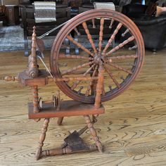 1884 double table Scandinavian spinning wheel. It has a maker's mark and a date, but we aren't sure who the maker is.