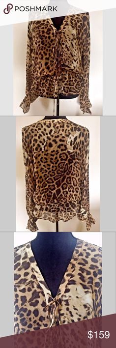 Roberto Cavalli Silk Animal Print Lace Front Top Absolutely stunning Roberto Cavalli lace-front animal print blouse.  This blouse is from my own personal collection.  I purchased it at the Roberto Cavalli boutique in the Dominican Republic for $1170 and wore it once while on vacation.    100% silk Lace up front design Loose fitting upper body design Animal print in shades of browns Cavalli signature fabric Elasticized cuffs and waist Dry clean only Made in Italy  MEASUREMENTS  Bust measures…