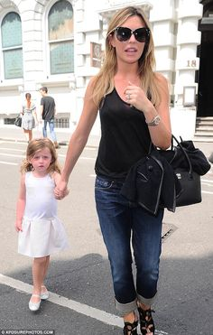 Abbey Clancy.. black semi-sheer top, 3/4 jeans, and Chanel executive cerf tote..