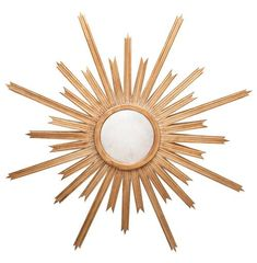 Appreciate the sunrise any time of day with this glorious golden star. The round, antique mirror at the center contrasts with slightly distressed metallic rays. Oversized and inviting, the artwork adds a natural ambiance to any area.