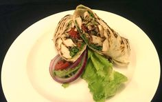 It's a wrap with today's delicious lunch feature!! Lemon Yogurt-marinated Chicken Wrap with Balsamic-Cilantro Cole Slaw, Rosemary-roasted Tomatoes & Basil Mayo.