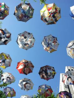 """Children's Umbrella Painting Show on the sky at the Seoul City Hall, Seoul, South Korea 2014, themed """"My Happy Family"""""""