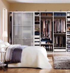 an image of an Ikea PAX wardrobe system with sliding doors the go across a full wall to provide a large amount of organized clothing storage Ikea Closet System, Closet Ikea, Pax Closet, Ikea Pax Wardrobe, Bedroom Wardrobe, Master Bedroom, Closet Space, Ikea Bedroom Furniture, Wardrobe Systems