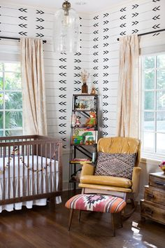 Eclectic little baby room. Loving the walls.