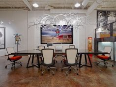 modern day office space with large infused antler chandelier, modern day lighting, shawn rivett designs