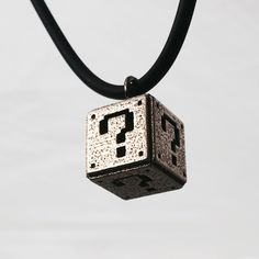 Super Mario Question Box Pendant - Nintendo Geek Gift ($23) ❤ liked on Polyvore featuring jewelry, pendants, necklaces, charm pendants, layered jewelry, polish jewelry, nintendo and grey jewelry