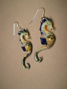 Hey, I found this really awesome Etsy listing at http://www.etsy.com/listing/117095193/blown-glass-sea-horse-earrings