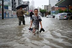 Week of Jun 21-27, 2014 People wade through flooded streets in Recife, Brazil, where the U.S. lost a soccer match to Germany on Thursday, 1-0, but still managed to move through to the round of 16 in the 2014 FIFA World Cup championship. Patrik Stollarz/Agence France-Presse/Getty Images