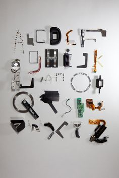 type face made from deconstructed camera by Stefan Abrahams, via Behance....BRILLIANT!!!