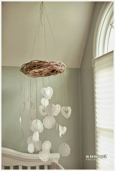 DIY baby mobile made from lace doilies