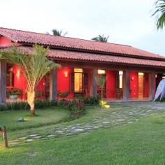 Casa Vermelha: Terraços translation missing: br.style.terraços.campestre por Andréa Calabria Arquitetura