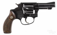 Smith & Wesson Model 30 six-shot revolver, .32 caliber, 3'' barrel, serial #649334. R - Price Estimate: $100 - $200