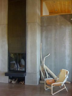 fireplace - House in Orcas Island with fireplace with gray concrete panels oversized tile as hearth surround