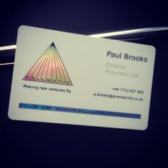 A white plastic business card printed with holoprint and metallic light blue ink