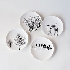 Naturescape Bone China Plates - Set of 4 Enjoy the beauty of the country while eating from these gorgeous bone china plates. Each plate displays a poetic scene in nature. Whether used as dinner plates or serving plates, this set is bound to have everyone thinking about the outdoors, right from the comfort of your rooftop.