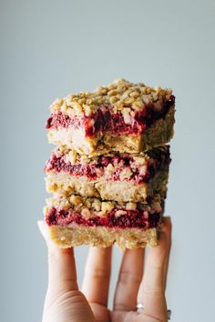 Raspberry Crumble Bars that are soft and thick and loaded with juicy raspberries. Essential summer dessert! #raspberrybars #dessert #raspberry #summerdessert | pinchofyum.com