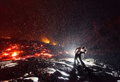 Lava Kiss. Contestant said: My husband and I, along with a tour guide and a group of friends, hiked up to what was formerly the Royal Gardens subdivision above Kalapana, Hawaii, where the last standing house was just recently taken over by the active lava flow. While waiting for the rain to pass, we started taking back-lit portraits of each other in front of the lava flow after I set up my camera on the tripod. For the last photo, my husband spontaneously dipped me in a kiss.