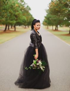 black tulle wedding dress and a black leather jacket