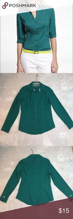 """Express brand, """"The Essential Shirt"""". Size medium Green Express brand, """"The essential shirt"""". Sz medium. Has normal collar and buttons down front. Slight v necklace at front neckline. Very sexy tapered side cut near waist to make you look slimmer. All buttons & button holes are functioning. Long sleeved but sleeves may be rolled up if desired. Has silver express logo bar sewn near cuff. 2 buttons on each sleeve that may be unbutton too. Fabric is not faded and is in good like new condition…"""