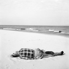 Vivian Maier - Lying drunk on the beach