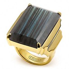 Coach Jewelry - Lavish and alluring, this Art Deco-inspired ring showcases a bold black quartz stone in a striking emerald cut. Its architectural design makes a statement with a magnificent, gold-washed sterling silver setting cast into a striking stepped motif.  Gold-plated sterling silver with black quartz stones