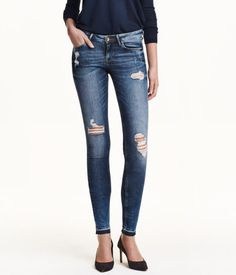 5-pocket, low-rise jeans in washed stretch denim with ultra-slim legs and heavily distressed details.
