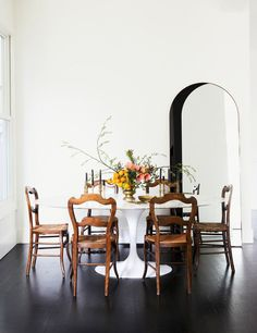 Minimalist Dining room with arched entry and charming antique chairs, surrounding a tulip table Dining Room Lighting, Dining Room Chairs, Dining Room Furniture, Dining Rooms, Furniture Ideas, Office Chairs, Furniture Stores, Cheap Furniture, Home Interior