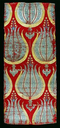 Lampas-woven textile with tulips, silk and silver lamella. Turkey; 2nd half of 16th century. Large, stylized tulips make it a fine example of the highly original and magnificent patterns that were designed in the Ottoman court studios. So much gold and silver thread was used for certain textiles that the sultans prohibited their production for periods, since they drained the reserves of precious metals.