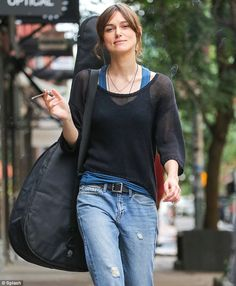 Puffed out: Keira Knightley was pictured smoking and strolling on the set of Can A Song Save Your Life? in New York