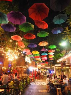 Colourful hanging umbrellas in Chiang Mai, the harbour, Thailand. Watch our video with these stunning umbrellas :)